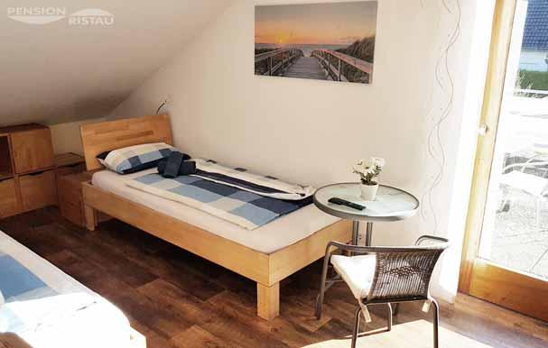 Pension in Bünde - Doppelzimmer mit Bio-Möbeln - Bettenansicht